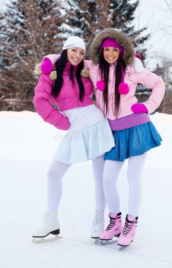 Download Two Girls Ice Skating Royalty Free Stock Image - Image: 12287066
