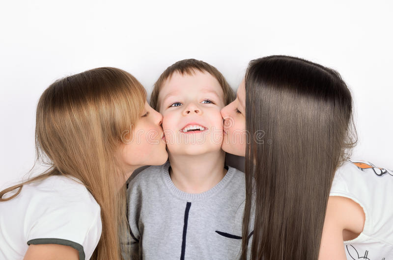 Two girls kissing boy royalty free stock photography