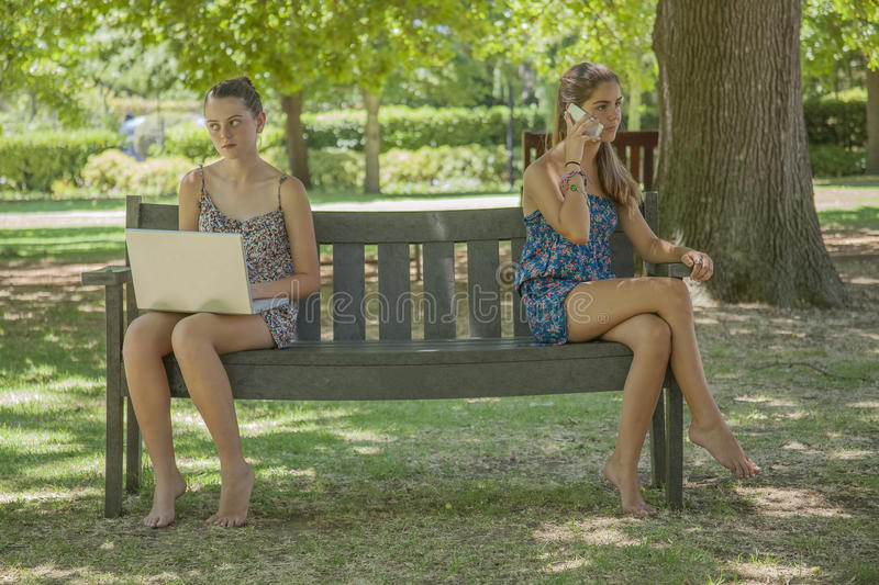 Download Two Girls With Laptop And Smart Phone Stock Image - Image: 28819707