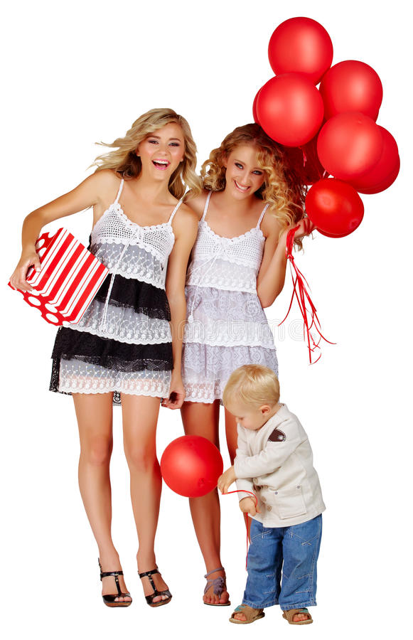 Two girls and a little boy with balloons. stock photo