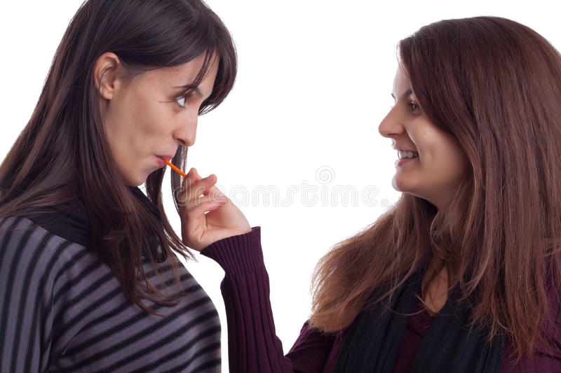 Download Two girls with lollypop stock photo. Image of standing - 22799602