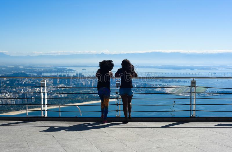 Two girls are looking at Rio de Janeiro stock photos