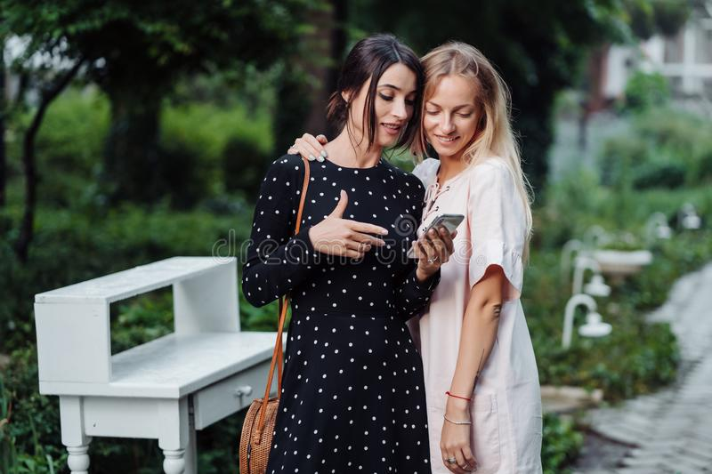 Two girls with mobile phone stock photo