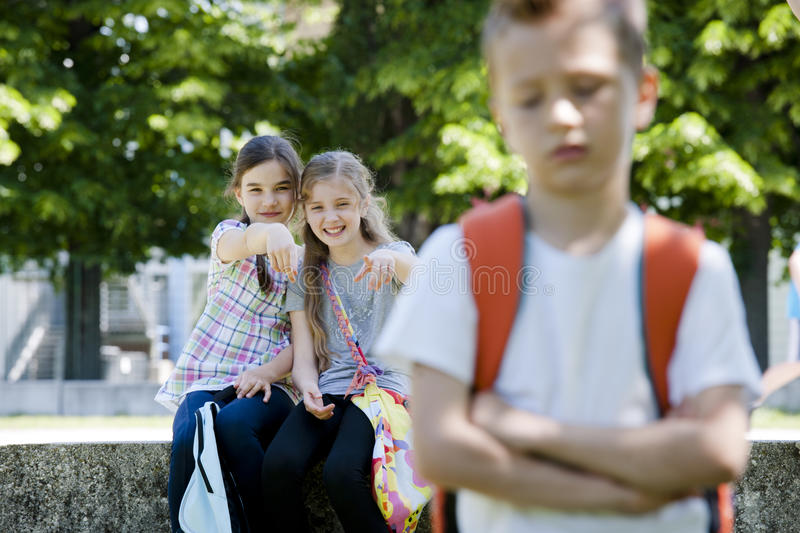 Download Two girls mocking a boy stock photo. Image of boys, little - 25928416