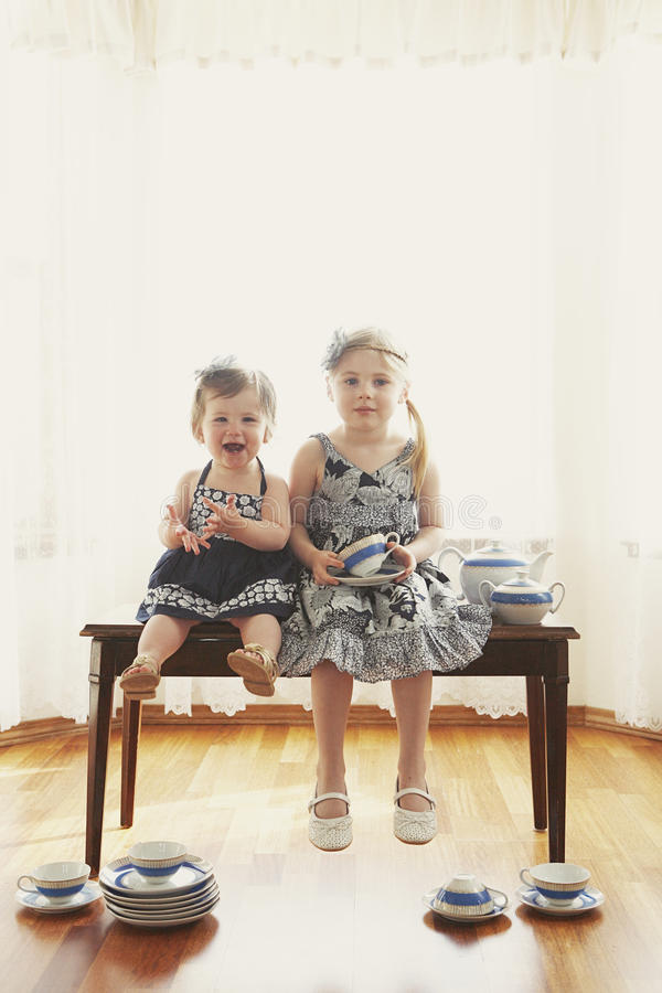 Free Two Girls On Bench With Dishes Stock Images - 13531594