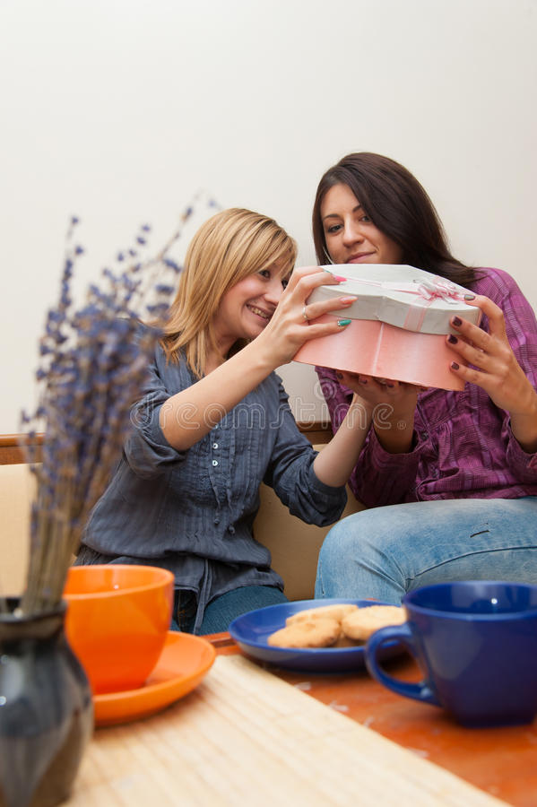 Two Girls Opening Present