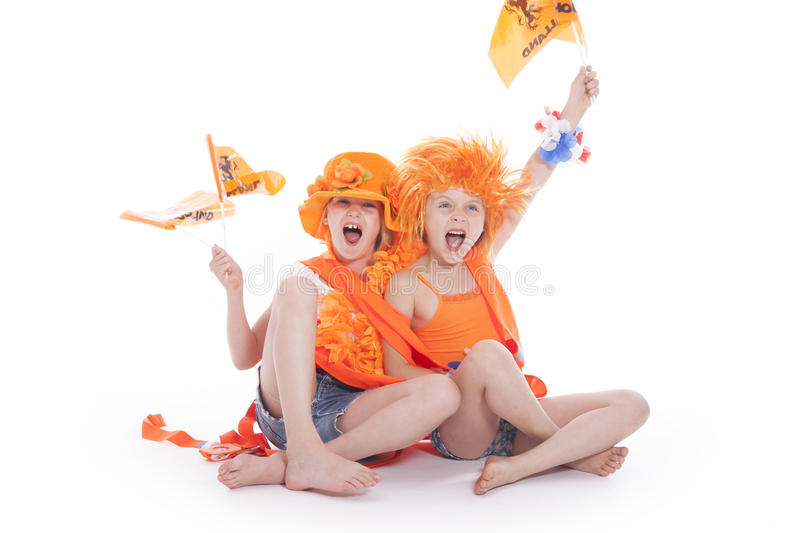Two girls in orange outfit cheering royalty free stock photo