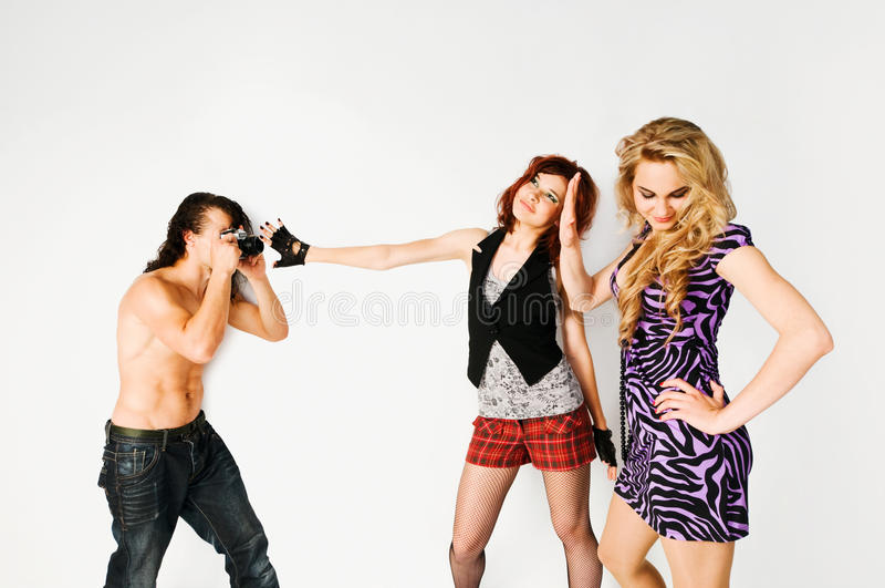 Two girls and a photographer stock images