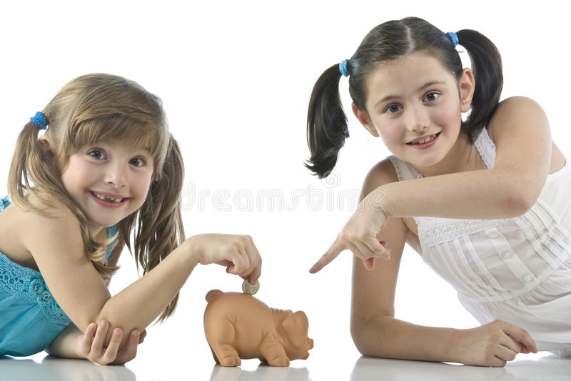 Download Two girls and piggy bank stock photo. Image of money, happy - 6953122