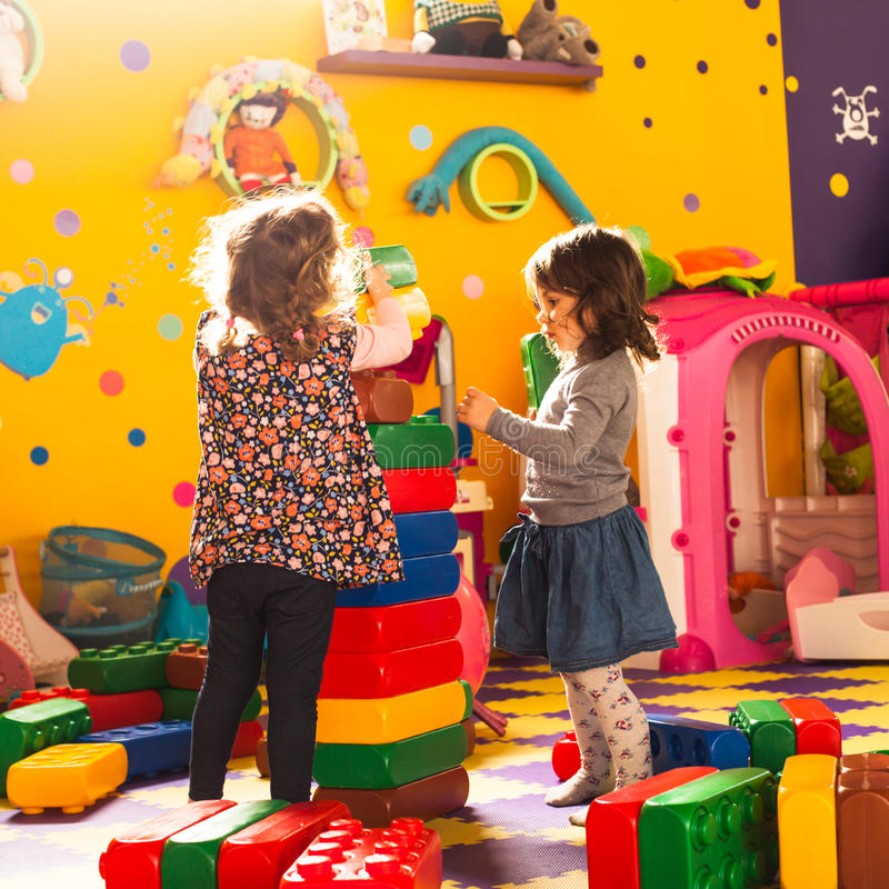 Two girls play royalty free stock images
