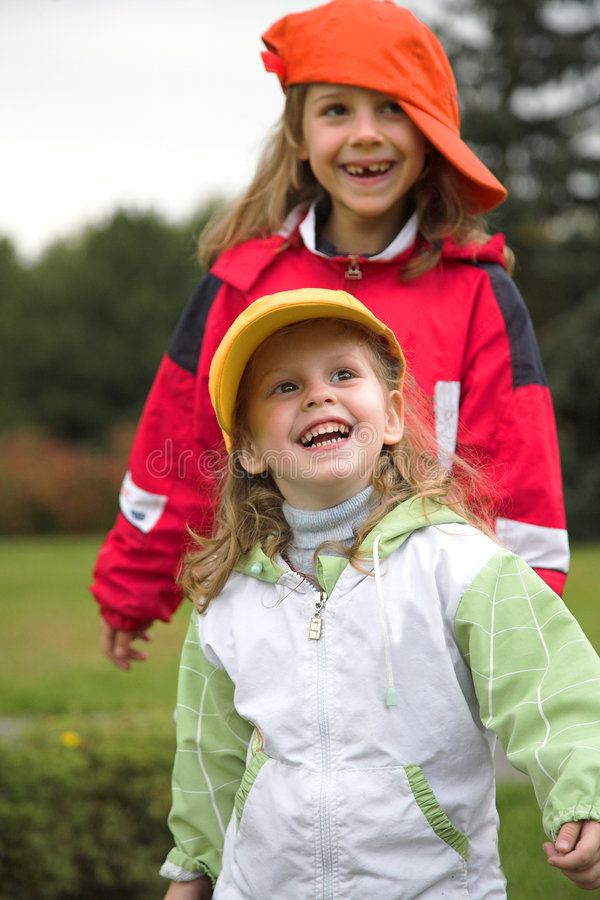 Download Two Girls Play With Cap Stock Images - Image: 1288454