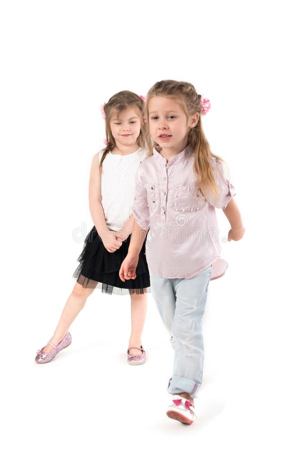 Two girls play outdoor games. Two girls preschooler play game. The picture is stock photo