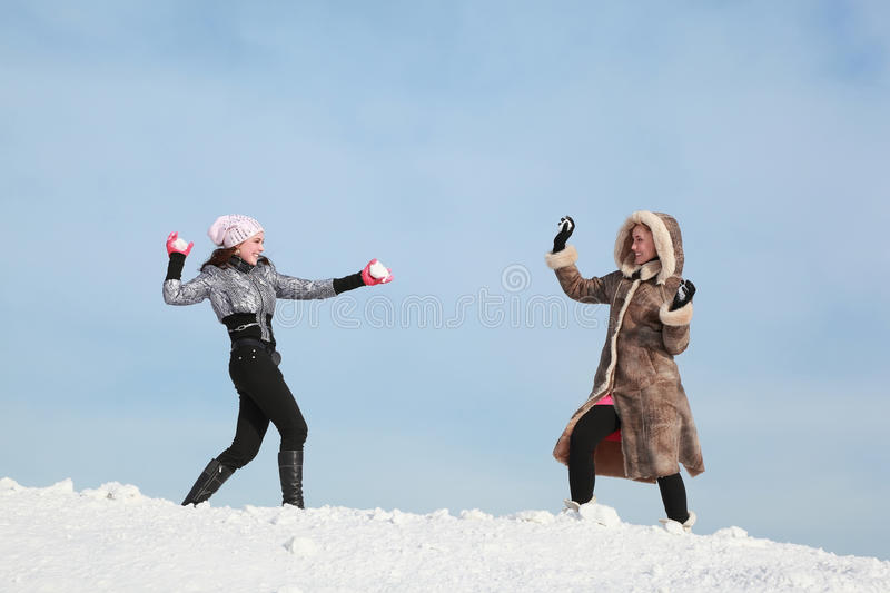 Download Two Girls Play Snowballs And Laugh Stock Image - Image: 19719787