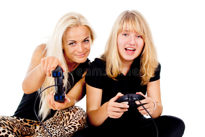 Download Two girls play video games stock image. Image of face - 27691259
