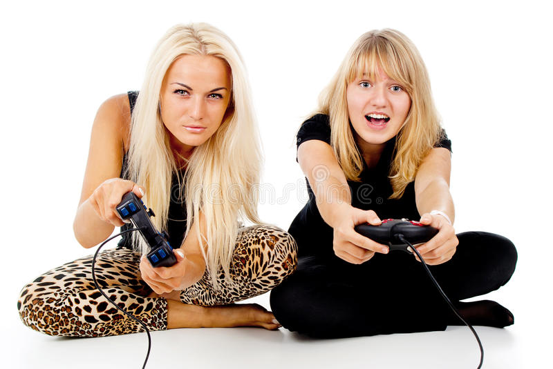 Two Girls Play Video Games Royalty Free Stock Images