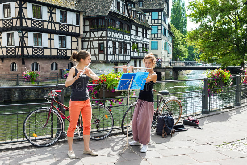 Two girls playing flute on the street in Strasbourg stock images