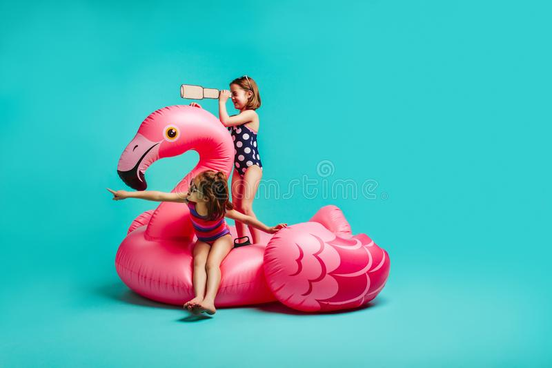Two girls playing on inflatable toy royalty free stock photos