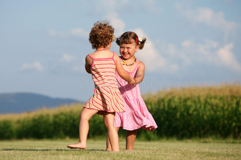Two girls playing outdoors royalty free stock photography