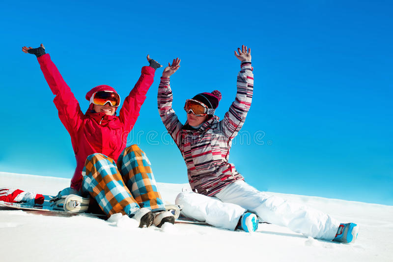 Two girls playing with snow royalty free stock image