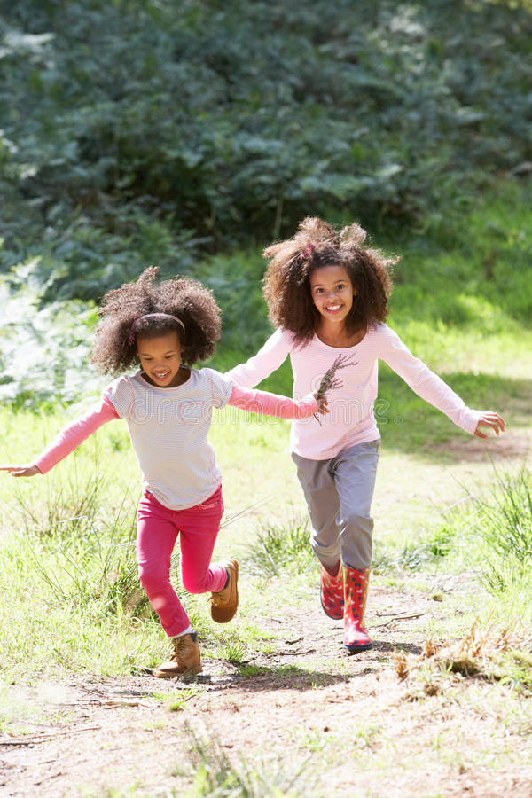 Two Girls Playing In Woods Together stock photography