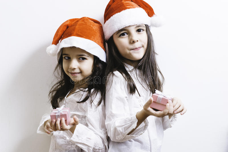 Two girls posing for Christmas and New Year holidays royalty free stock images