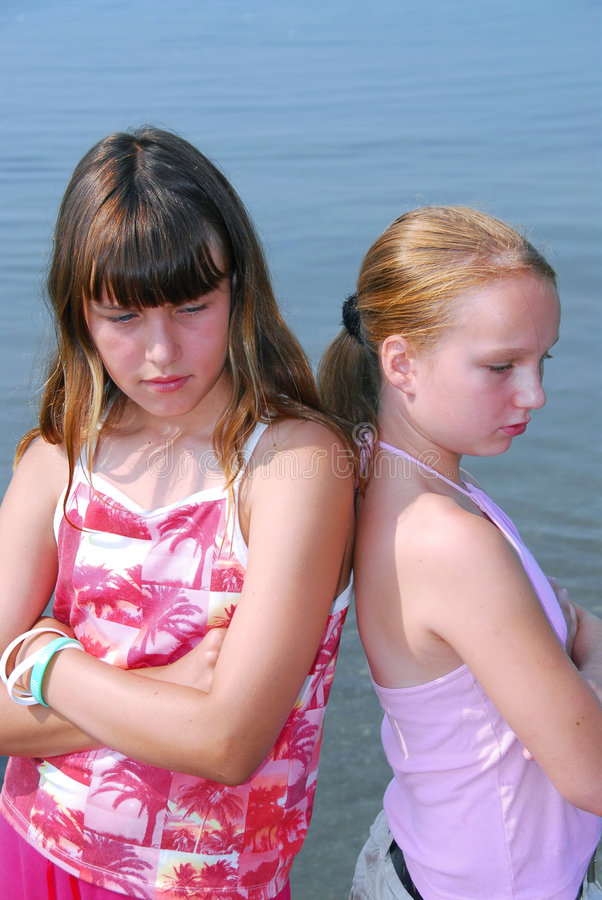 Two girls pouting stock photo