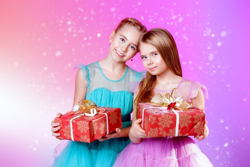 Two girls with presents royalty free stock images