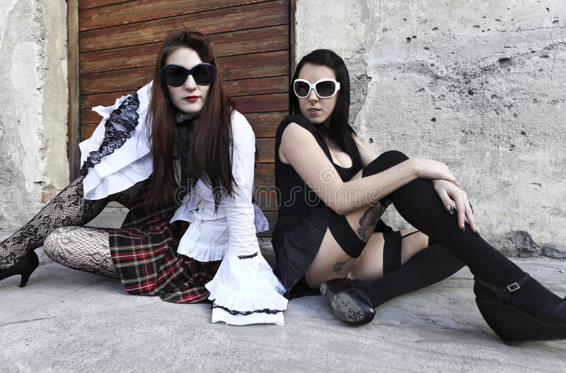 Two girls punk portrait royalty free stock photography