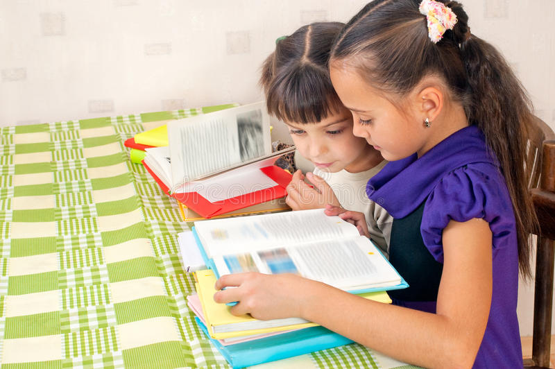 Two Girls Read Books Royalty Free Stock Photography