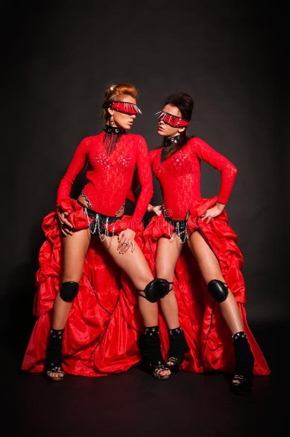 Download Two girls in red dresses stock image. Image of lezbiyanki - 33181451