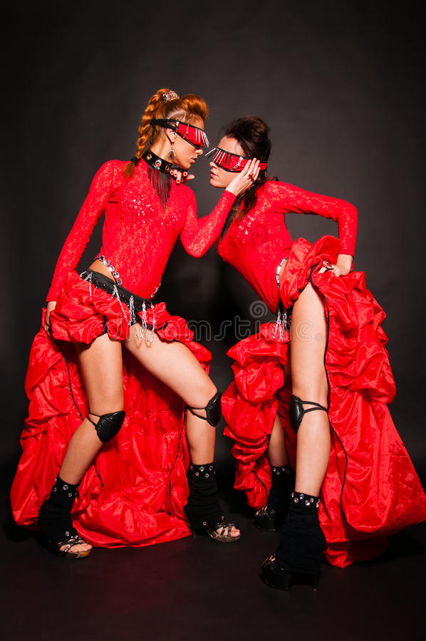 Two Girls In Red Dresses Stock Images