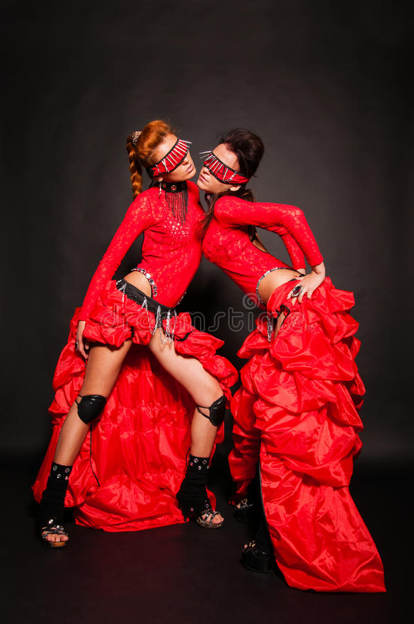 Two Girls In Red Dresses Royalty Free Stock Photography