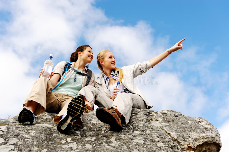 Two girls on a rock royalty free stock photos
