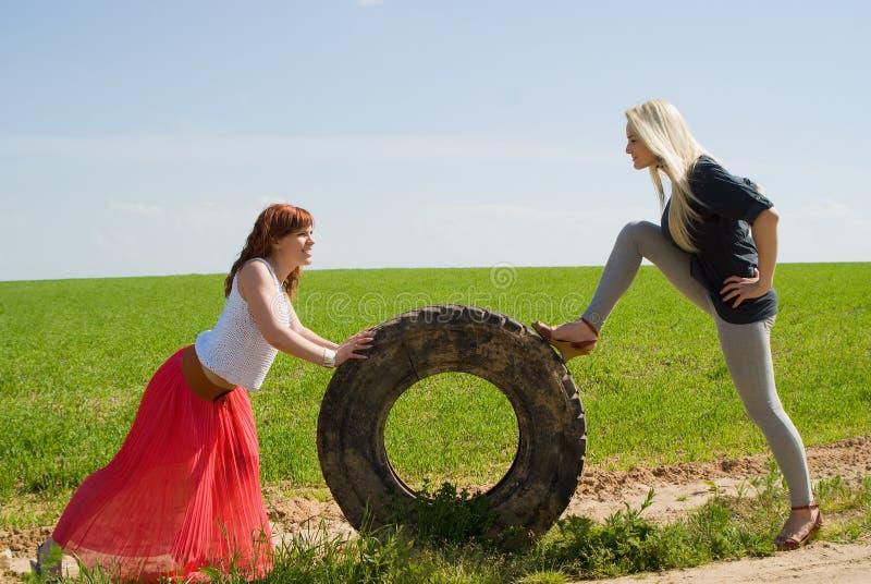 Two girls rolls wheel