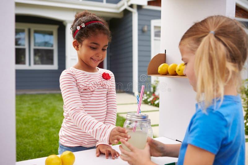 Two Girls Running Homemade Lemonade Stand stock photos