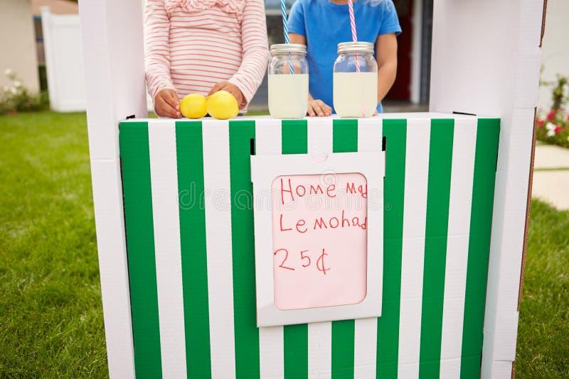 Two Girls Running Homemade Lemonade Stand royalty free stock photos