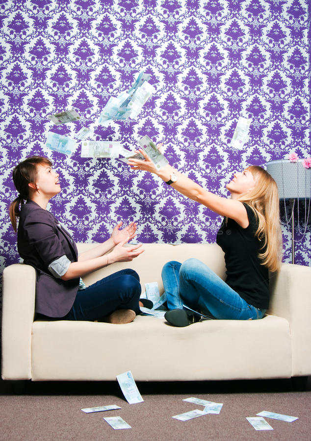 Download Two Girls Scatter Russian Rubles Stock Photo - Image: 27253966