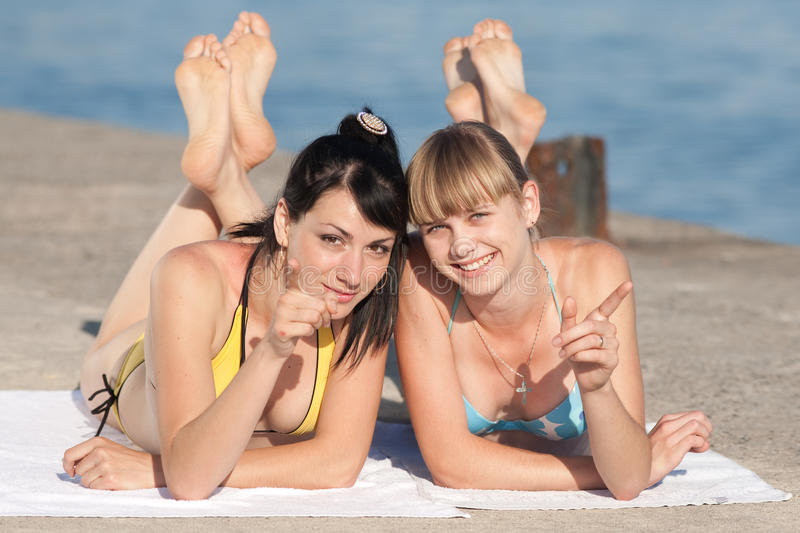 Download Two girls at the sea stock photo. Image of camera, smiling - 24747574
