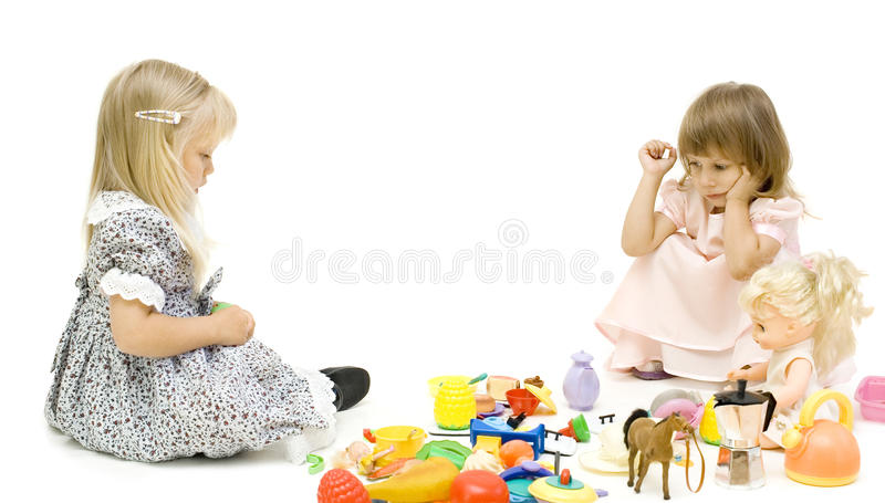 Download The two girls share a toy stock image. Image of white - 15792115