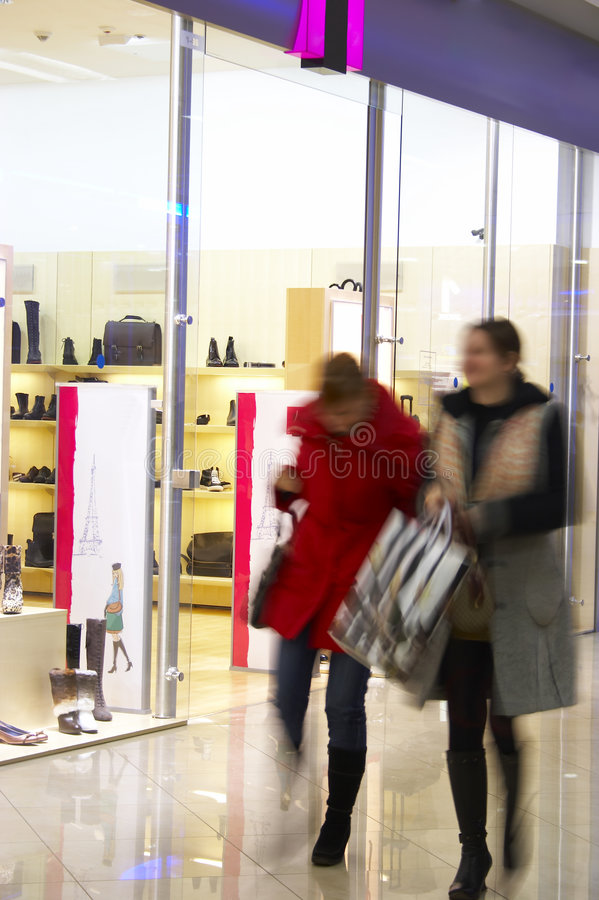 Two Girls In Shopping Center Royalty Free Stock Photography