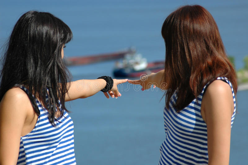 Two girls show hand on nave. Two young girls show hand on nave royalty free stock photos