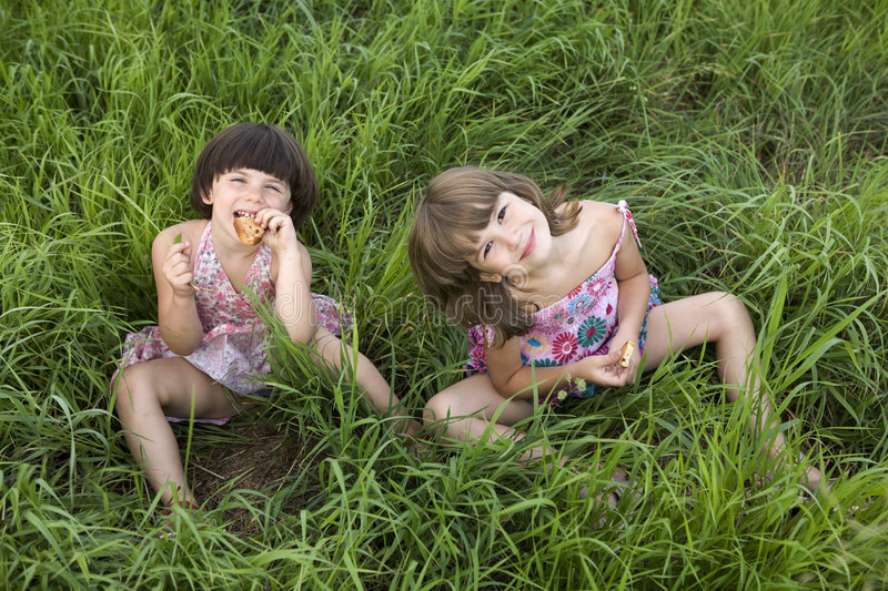 Download Two Girls Sitting In The Grass Royalty Free Stock Image - Image: 8290146
