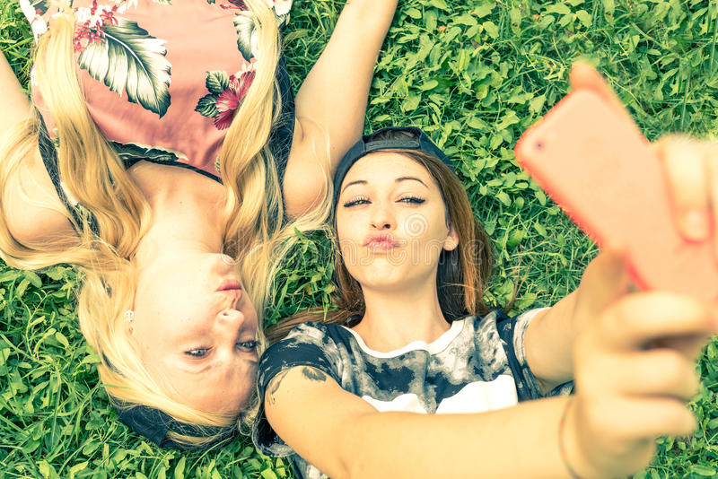 Two girls smiling at camera royalty free stock images