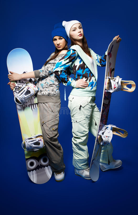 Download Two girls with snowboards stock photo. Image of cheerful - 18608416