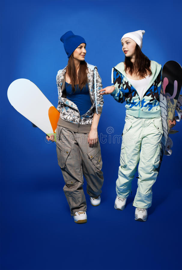Download Two girls with snowboards stock image. Image of resort - 18870885