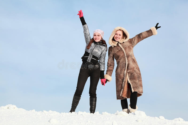 Download Two Girls Stand Alongside Hold On Hands Stock Photo - Image: 19719794
