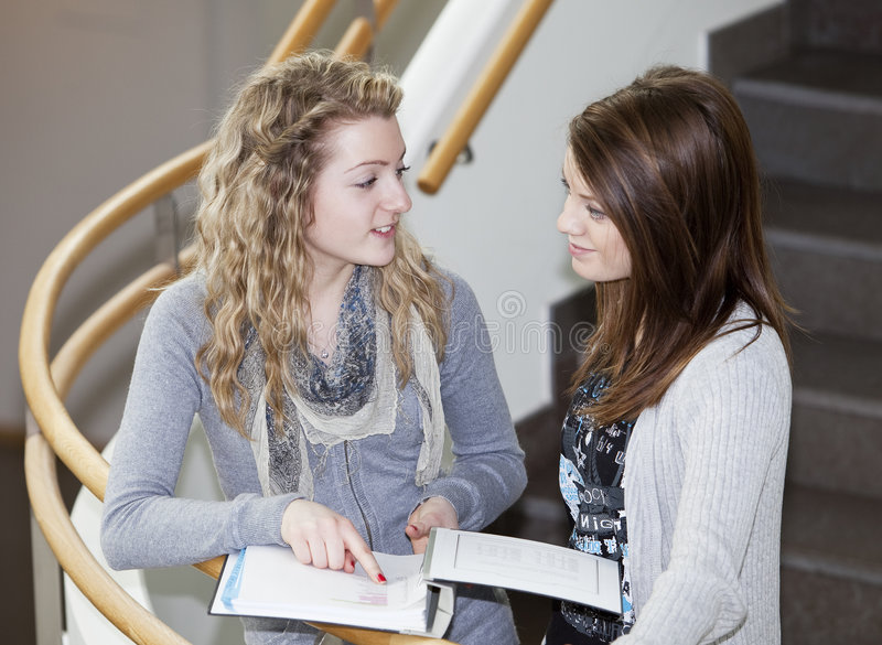 Two girls studying stock photography