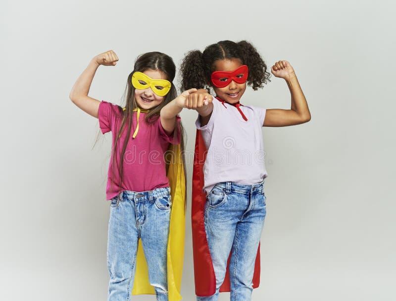 Girls in superhero costume royalty free stock photo
