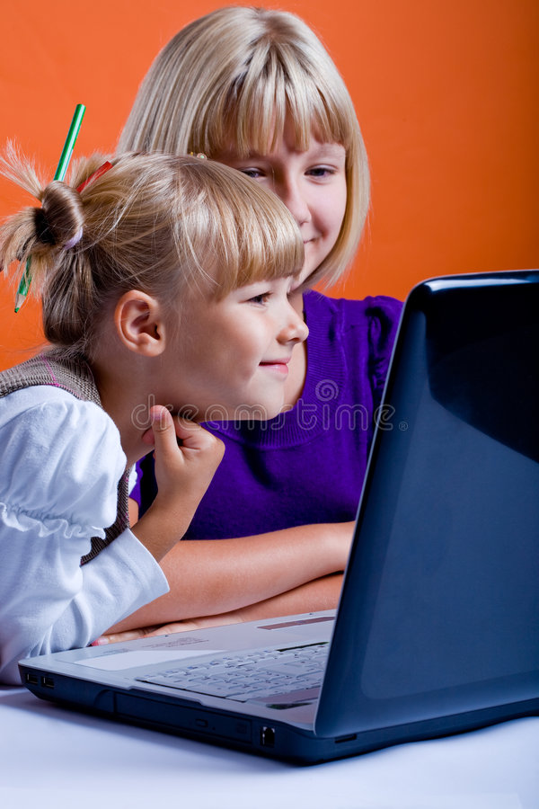 Two girls surfing internet royalty free stock photography