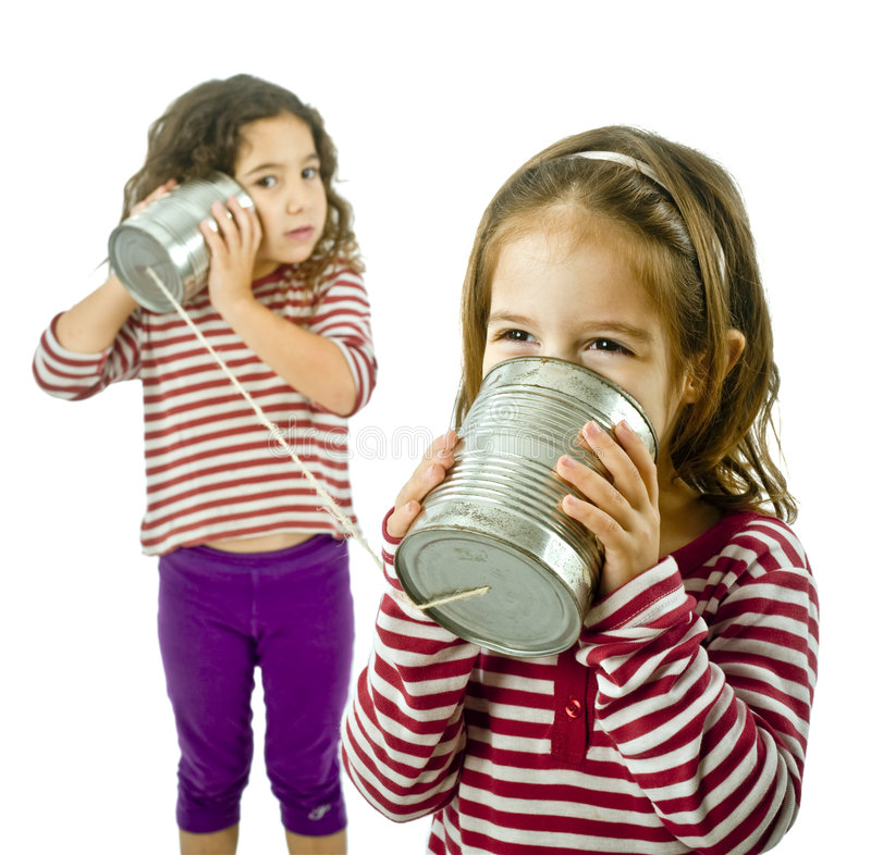 Two Girls Talking On A Tin Phone Royalty Free Stock Photos
